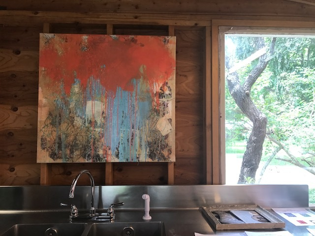 Another John Haubrich oil painting as backsplash
