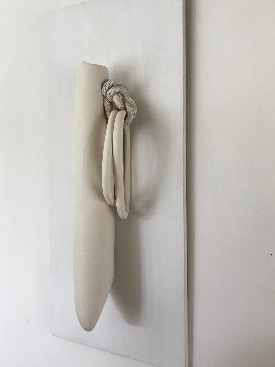 What We Carry, 2018, porcelain and rope, 23 x 10 x 4 in, $1,100