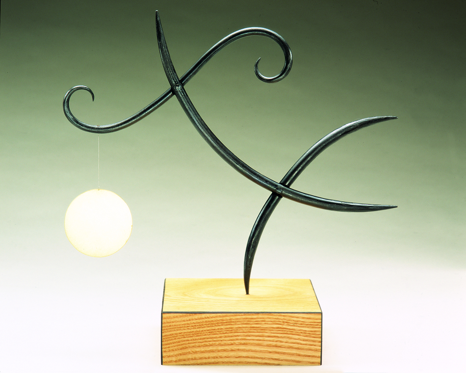 Chasing The Moon, 2002, steel, brass, wood, 16 x 18 x 7 in, SOLD