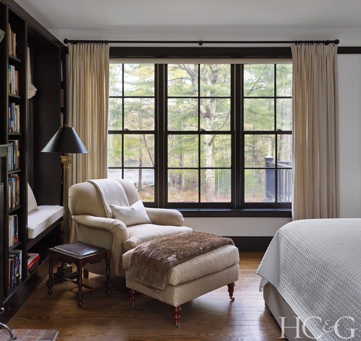 The master suite is outfitted with numerous seating areas for enjoying vistas of Larkin Pond or reading by the fire, such as a wood-and-cane daybed from India.