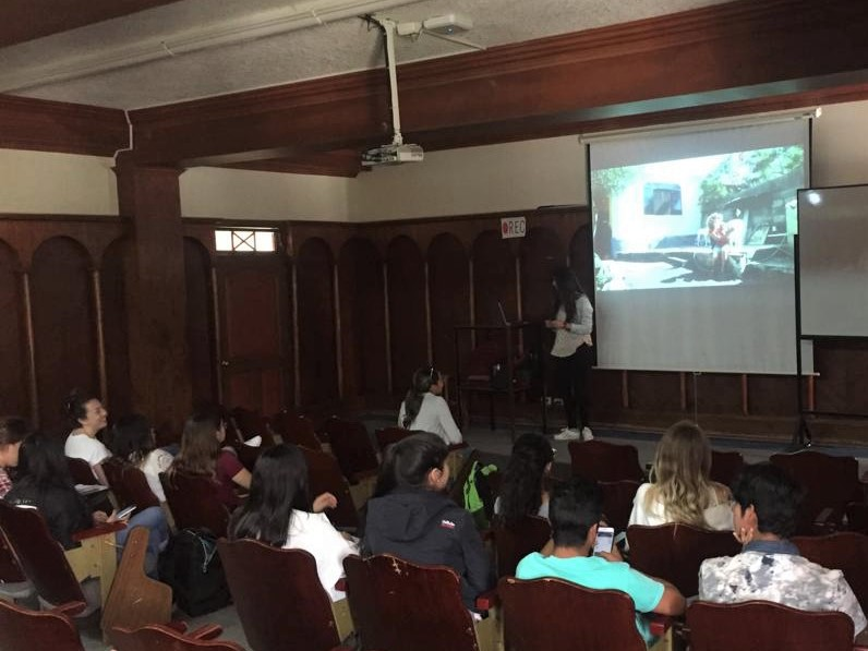 Figure 4.  Scholar Gabriela presents to her veterinary class about the role of veterinarians in conservation. Photo: Darwin Animal Doctors