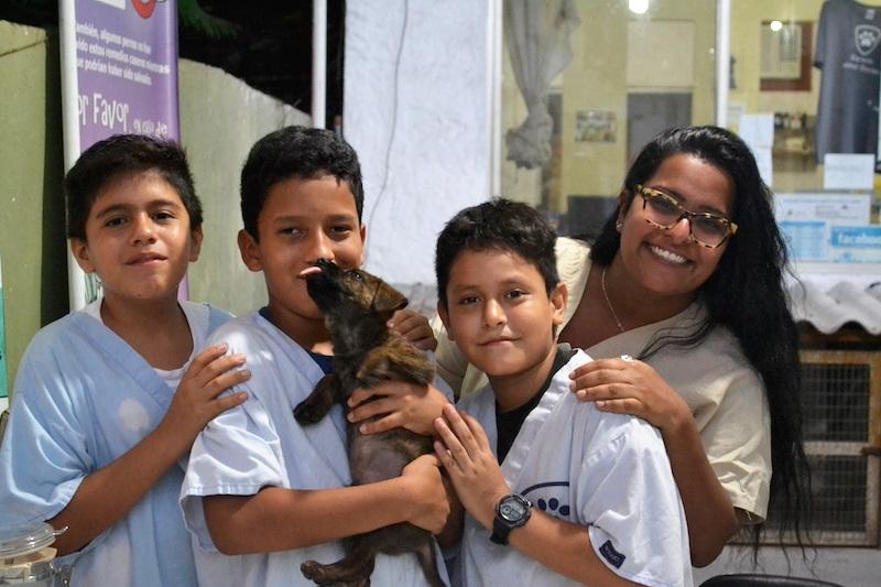 Figure 5.  Volunteer Nisha with three local youth volunteers. Photo: Darwin Animal Doctors