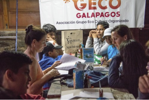 """Figure 2.  Signing the """"Going Back to a Plastics Free Ocean"""" project agreement with the Galapagos Conservation Trust. GECO implements this project with support from Galapagos Conservancy, Galapagos Conservation Trust, and the Celebrity Cruises Galapagos Fund."""