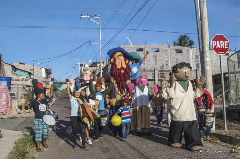 Figure 4.  Club ALIVE and GECO launch a play using giant puppets in the streets of San Cristóbal. Photo: José Guerrero
