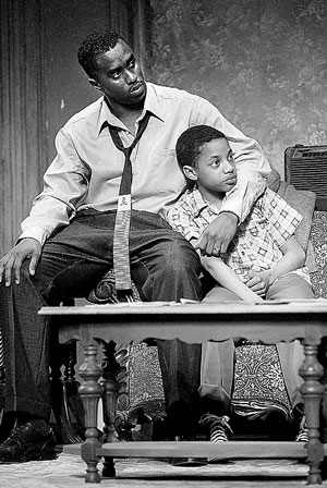 "Sean Combs as Walter Lee Younger and Alexander Mitchell as Travis, Walter's son in a televised adaptation of ""A Raisin in the Sun."""