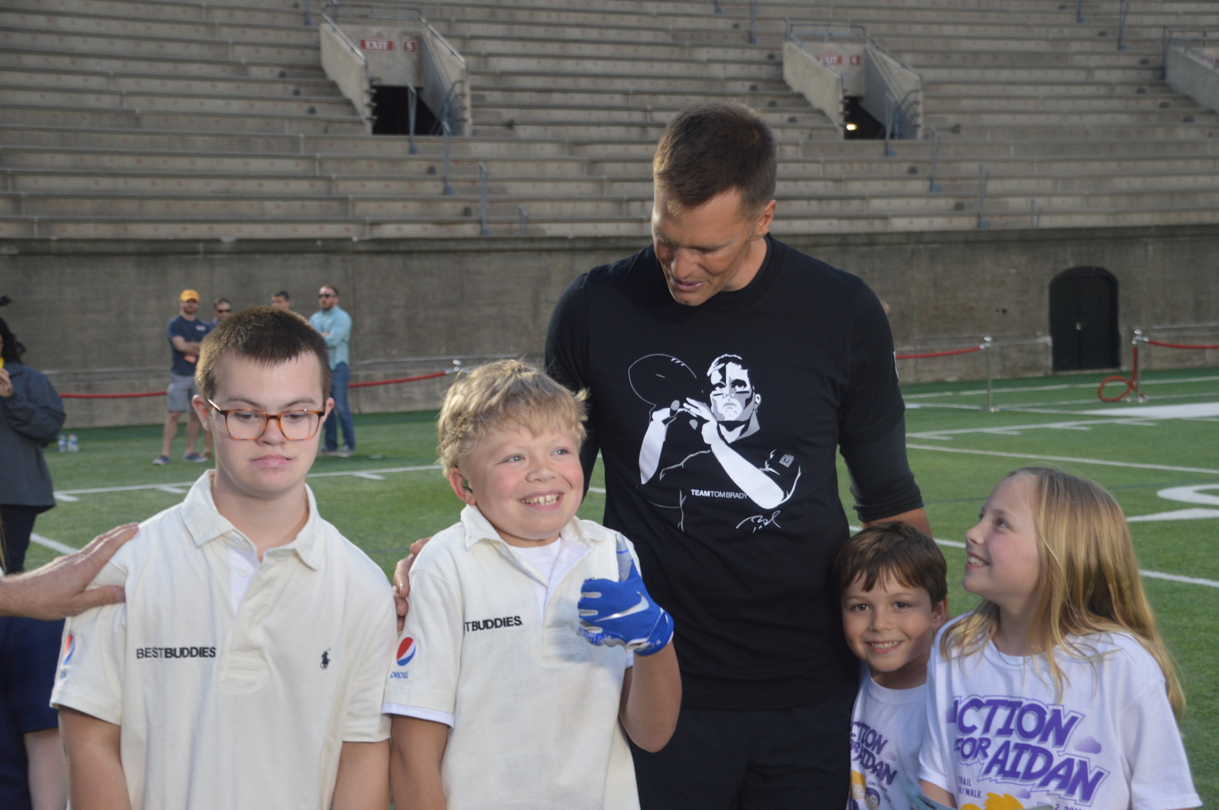 Aidan (middle) and friends with Tom Brady.