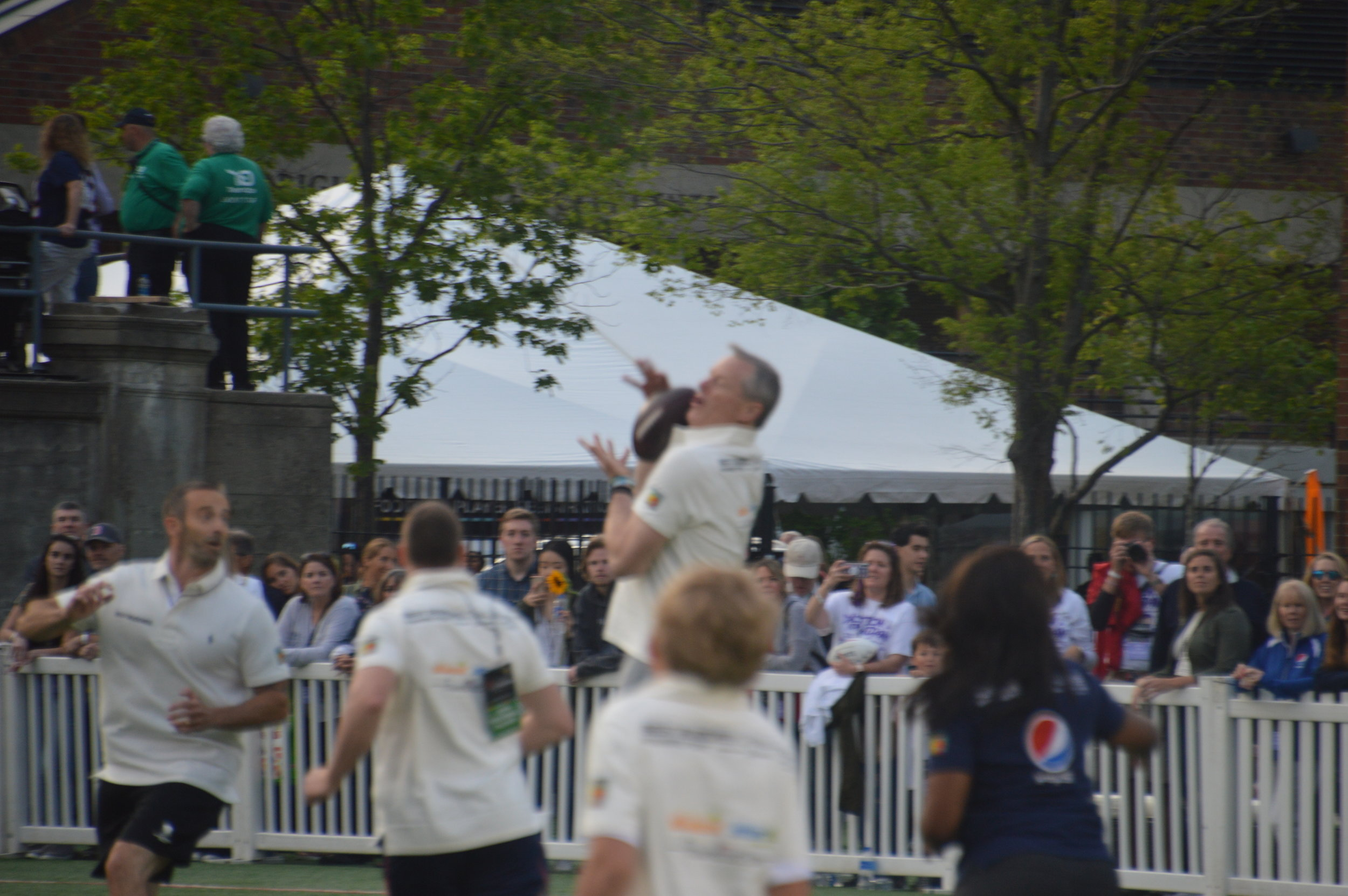 Governor Baker catches a pass during the 20th Annual Tom Brady Best Buddies Football Challenge.