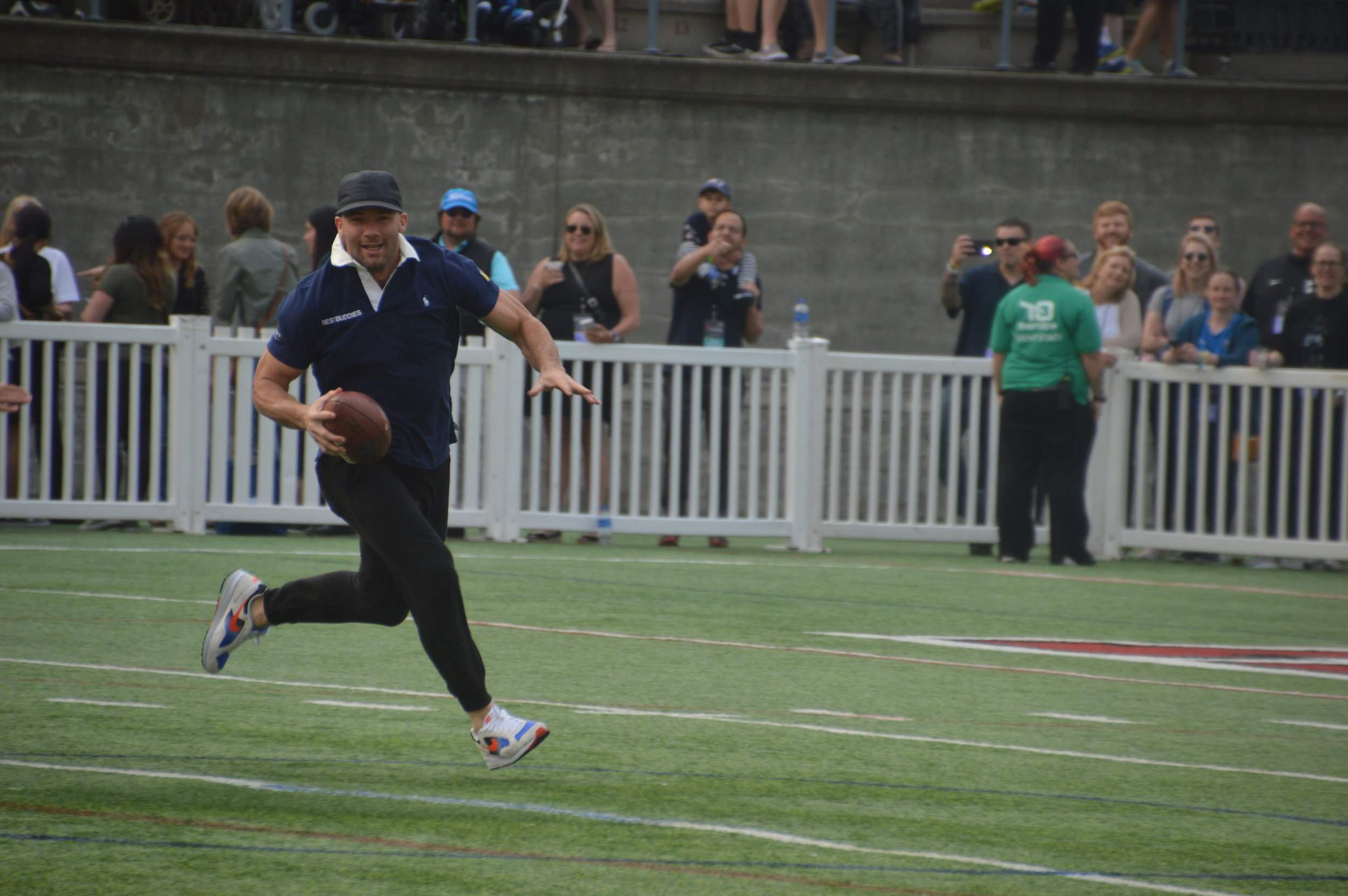 Julian Edelman runs across the field during the 20th Annual Tom Brady Best Buddies Football Challenge.