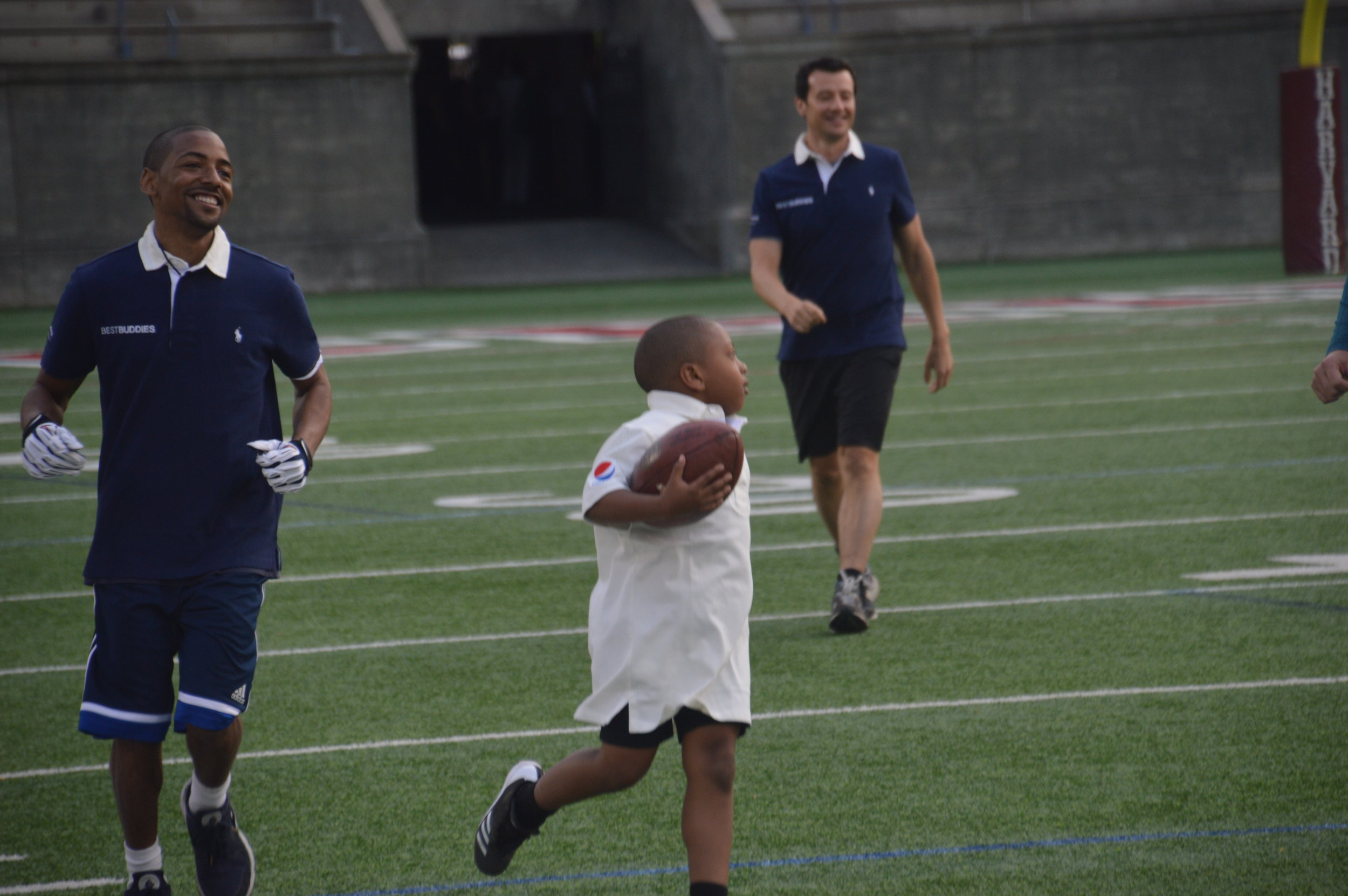 An athlete running during the 20th Annual Tom Brady Best Buddies Football Challenge.
