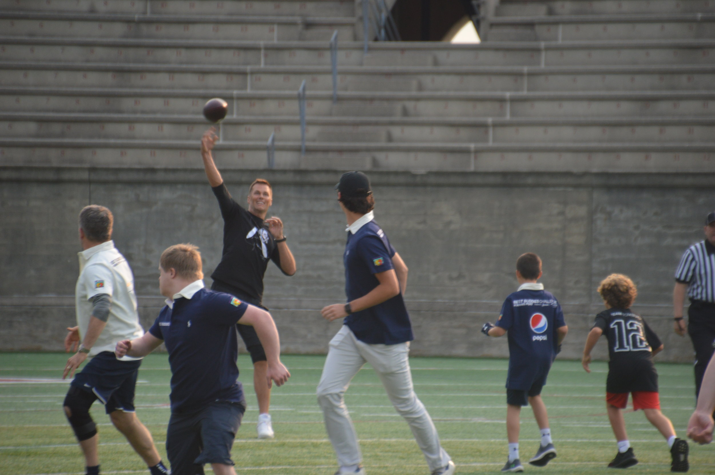 Tom Brady throws a pass during his 20th Annual Best Buddies Football Challenge.