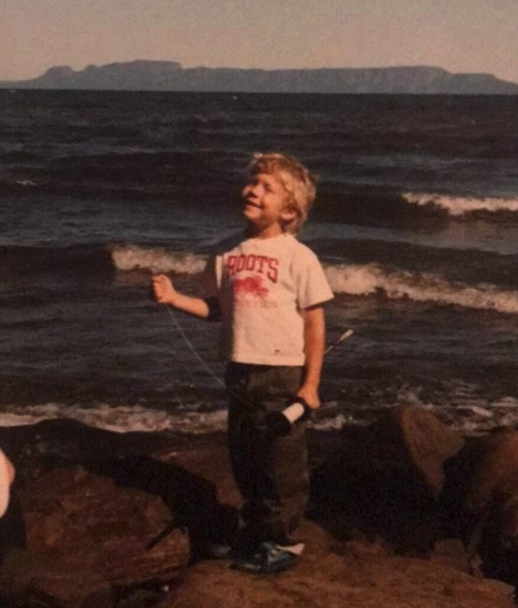 "Jesse O'Neil, age 5, kite-flying on the shores of Lake Superior, with his beloved 'Sleeping Giant' in the background. ""The sky's the limit!"""