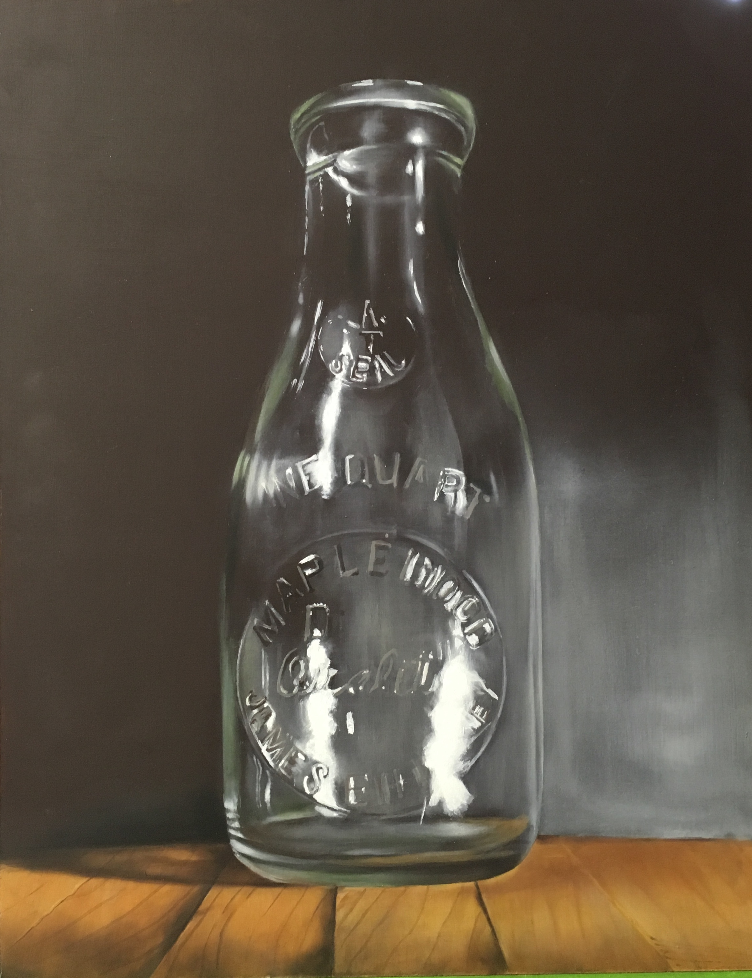 This is an old fashioned milk bottle that i picked up at a yard sale in Pennsylvania. I liked the way the light caused a high shine that blurred out some of the lettering embossed in the glass.
