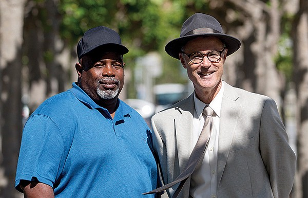 Byron Gill (left) and his attorney, Gregory P. Brock. (Jessica Christian/S.F. Examiner)