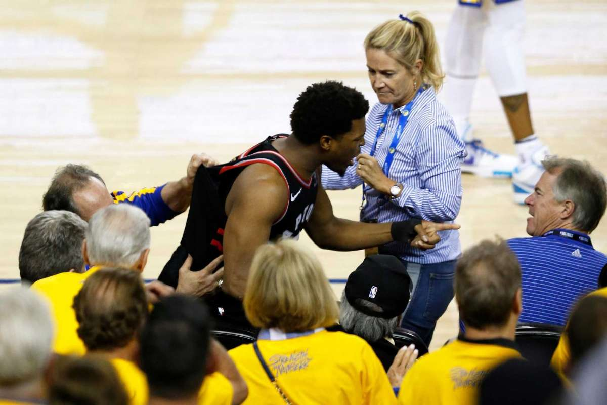 Toronto Raptors point guard Kyle Lowry pointing to Warriors minority owner Mark Stevens who shoved and cursed at Lowry for no reason during game four on the NBA finals.