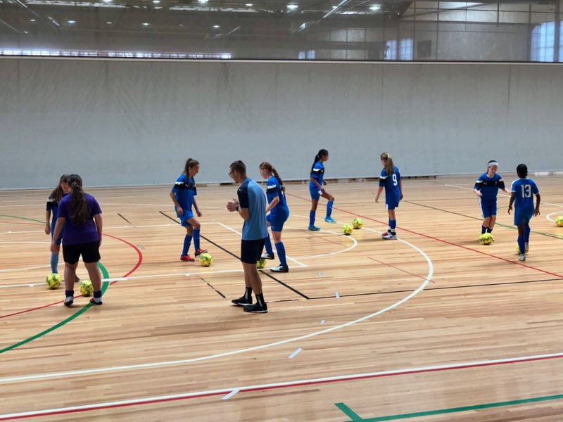 Shown here: Head Coach Pete Nowakowski working with the NSW Lightning U13s Girls side at the 2019 Futsal National Championships