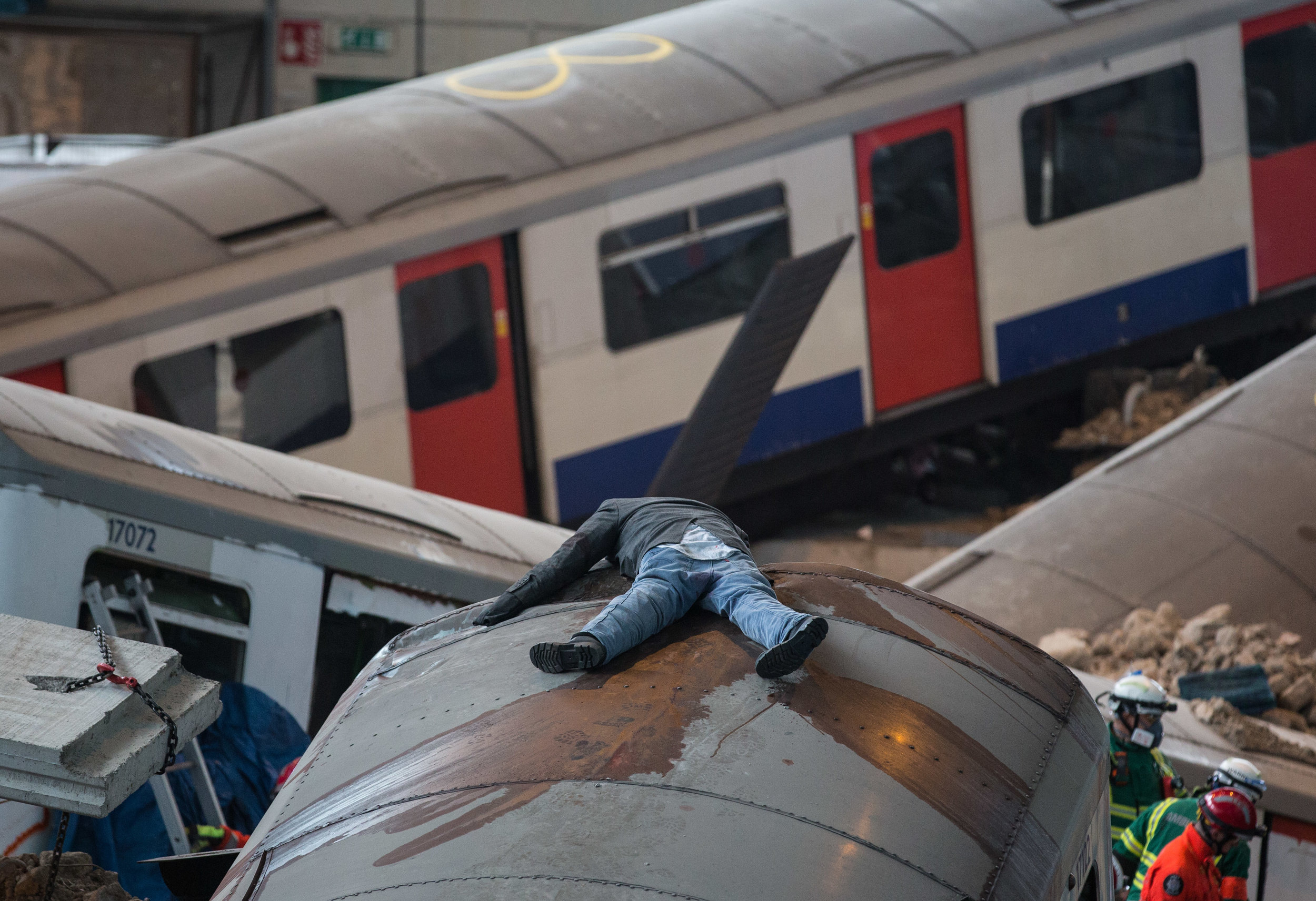 A blood splatted mannequin on top of a destroyed London Underground train carriage