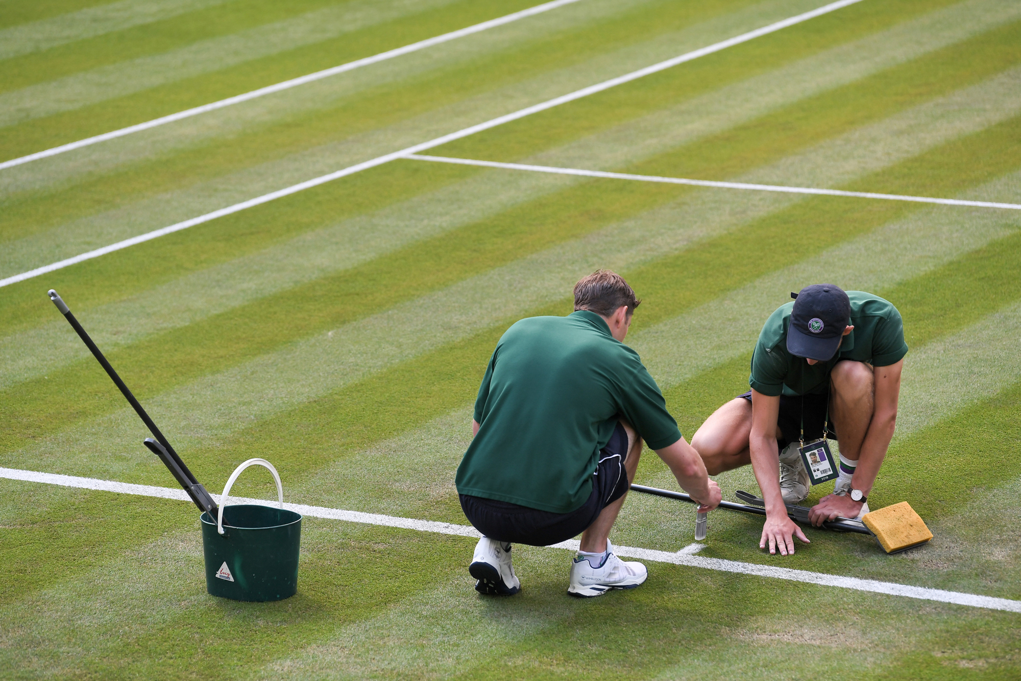 Ground Staff preparing the courts