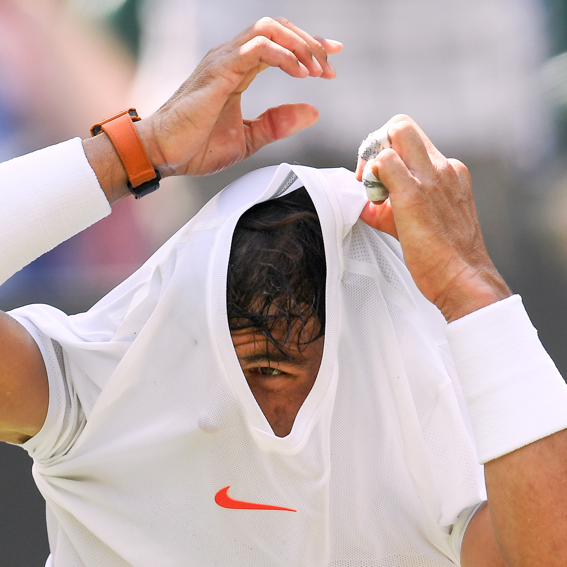 Rafael Nadal changing his shirt between games during his Gentlemen's Singles third round match