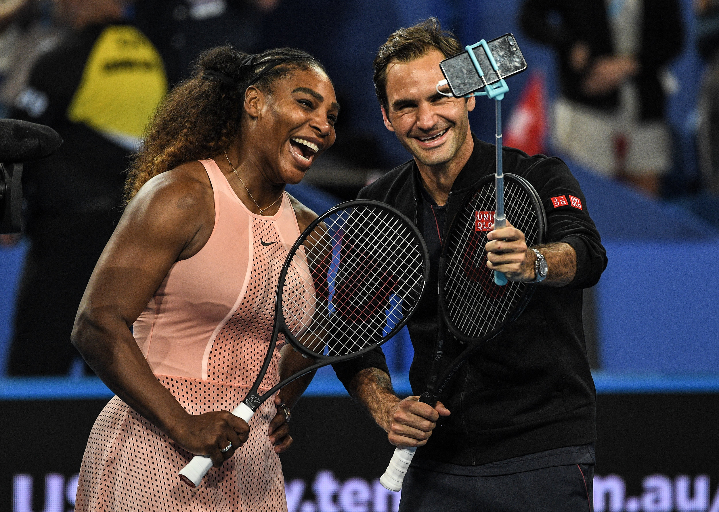 Roger Federer and Serena Williams take a selfie after their Mixed Doubles match