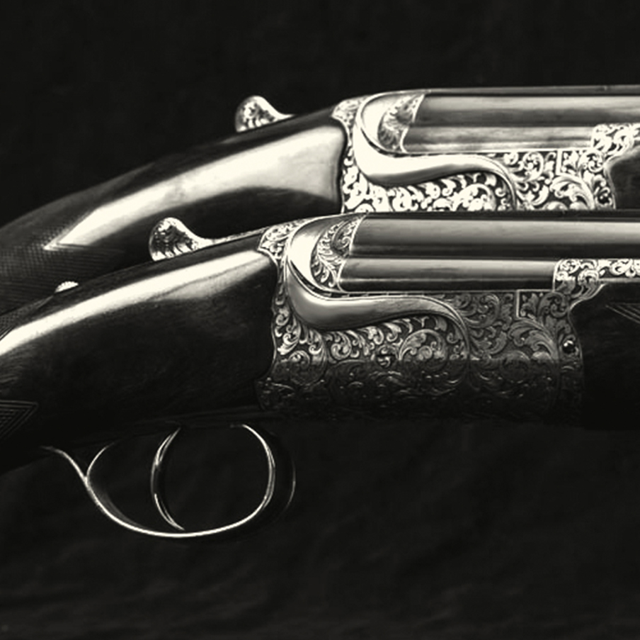 Pair of round action 12 bore over and unders.jpg