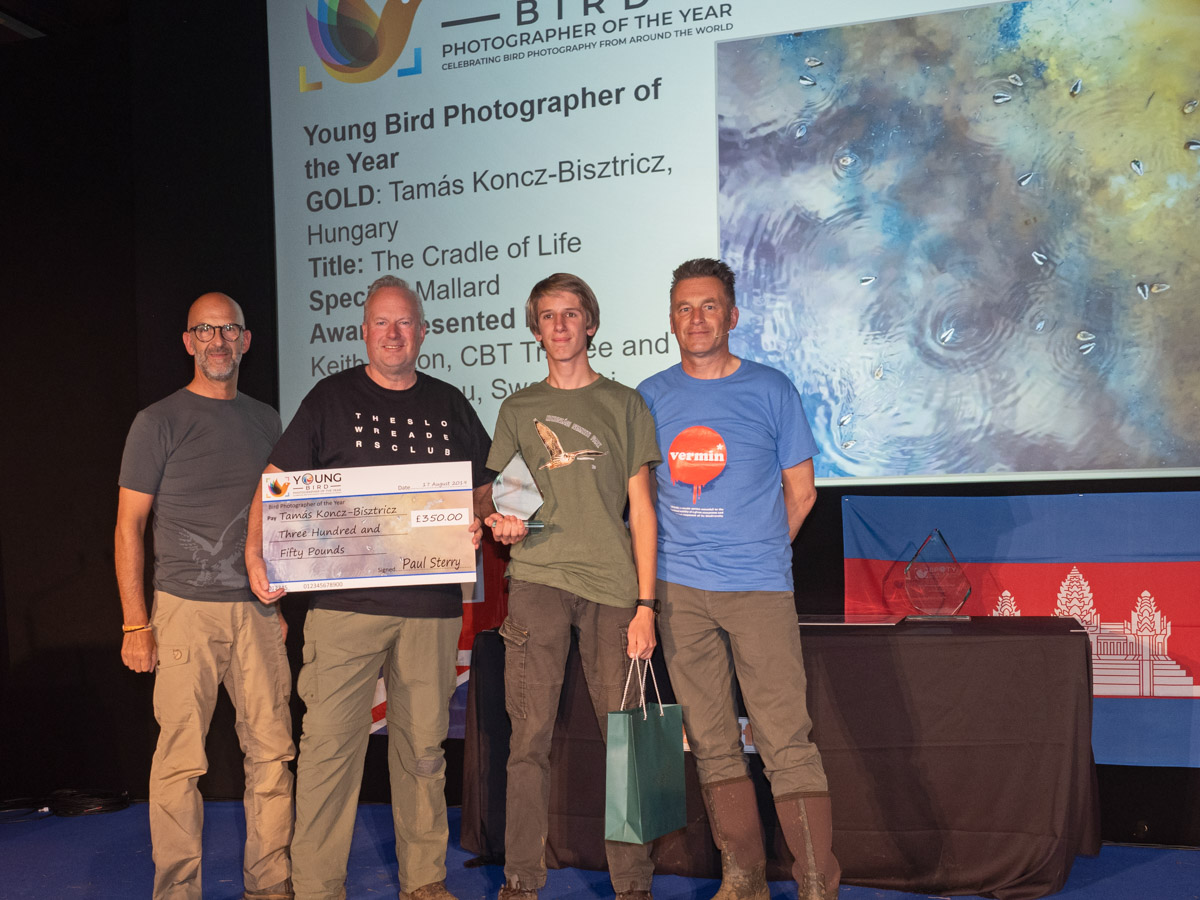 Young Bird Photographer of the Year 2019 winner Tamás Koncz-Bisztricz journeyed all the way from Hungary to collect his prize from Cameron Bespolka Trust trustee Keith Betton (centre left), Peter Antoniou of Swarovski Optik (left) and Chris Packham (right)
