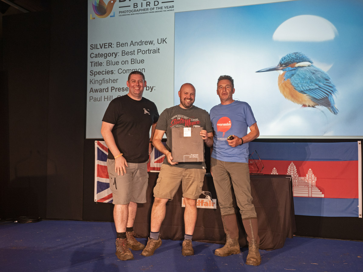 Ben Andrew from the UK, BPOTY 2019 Best Portrait Silver Award winner. Pictured with Paul Hill from Gitzo (left) and Chris Packham (right)