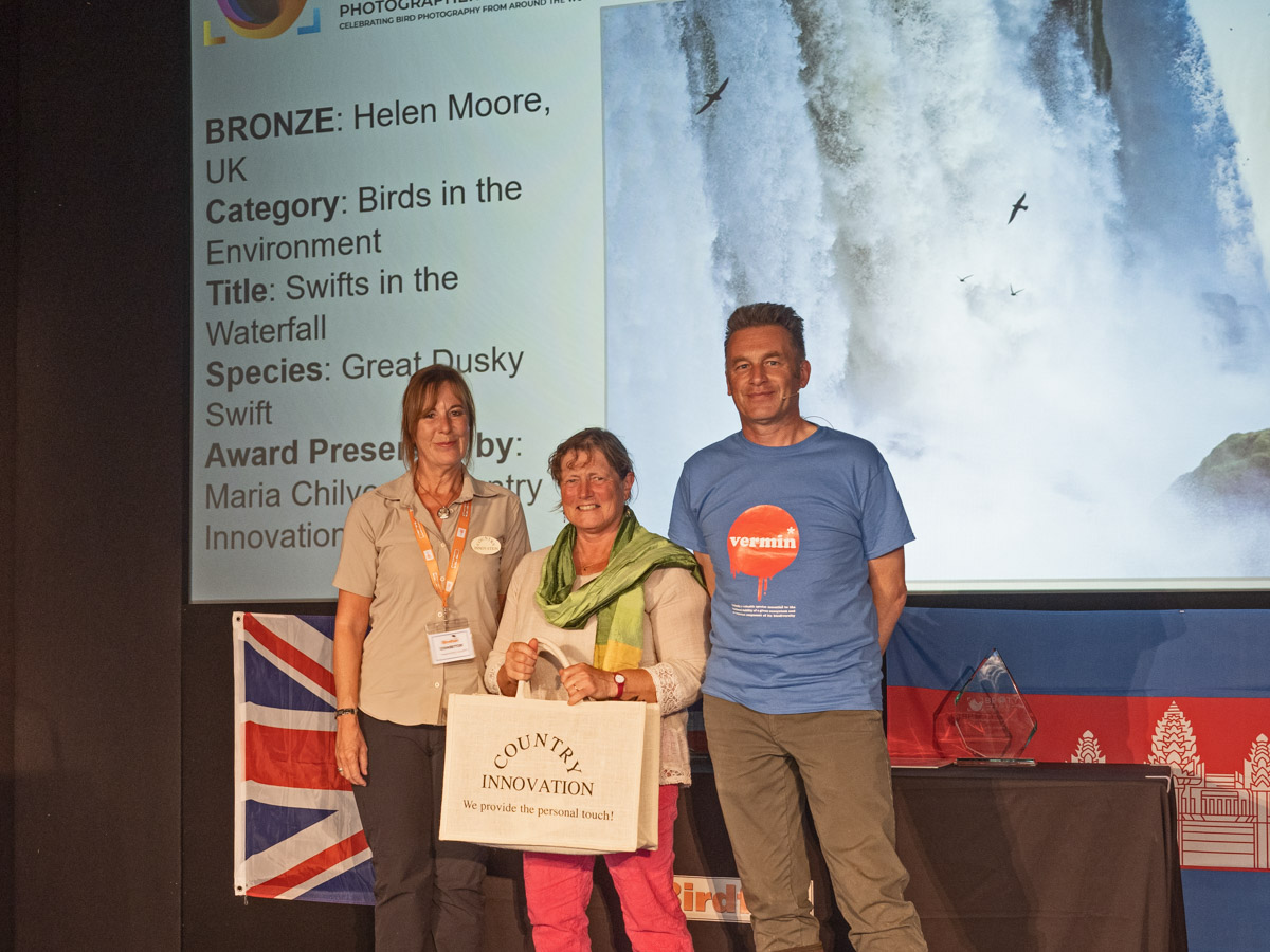 Helen Moore from the  UK, BPOTY 2019 Birds in the Environment Bronze Award winner. Pictured with Maria Chilvers of Country Innovation (left) and Chris Packham (right)