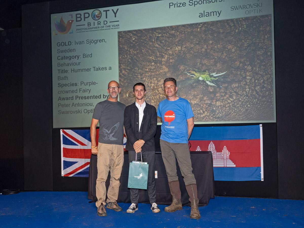 Ivan Sjorgren from Sweden, BPOTY 2019 Bird Behaviour Gold Award winner. Pictured with Peter Antoniou of Swarovski Optik (left) and Chris Packham (right)