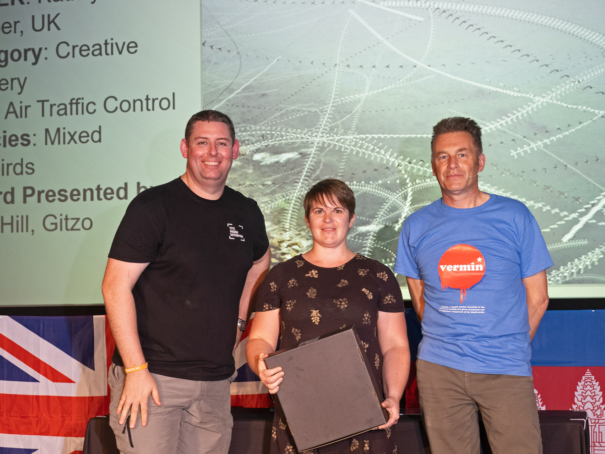 Kathryn Cooper from the UK BPOTY 2019 Creative Imagery Silver Award winner. Pictured with Paul Hill from Gitzo (left) and Chris Packham (right)