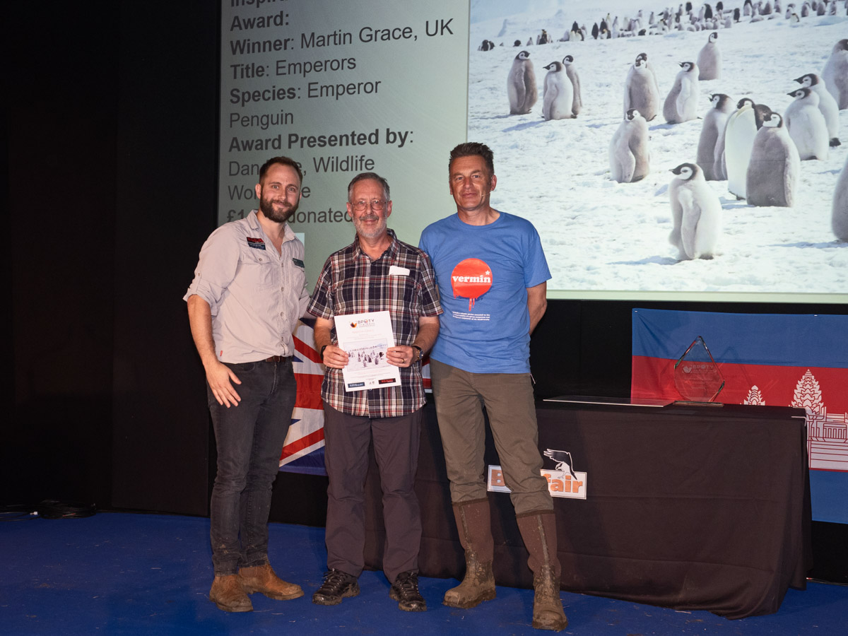 Martin Grace from the UK BPOTY 2019 Inspirational Encounters Award winner. Pictured with Dan Free of Wildlife Worldwide (left) and Chris Packham (right)