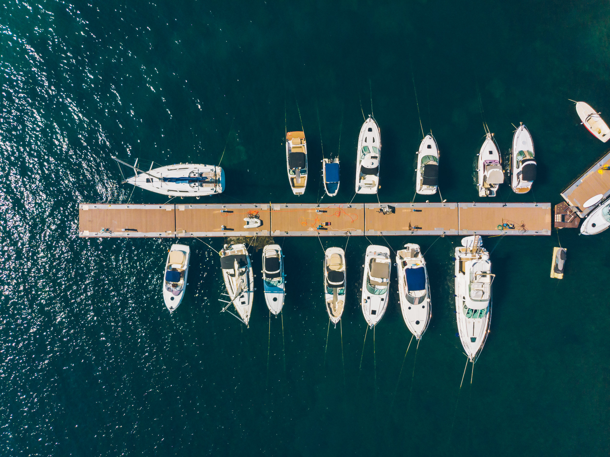 Aerial view looking down onto boats on a dock