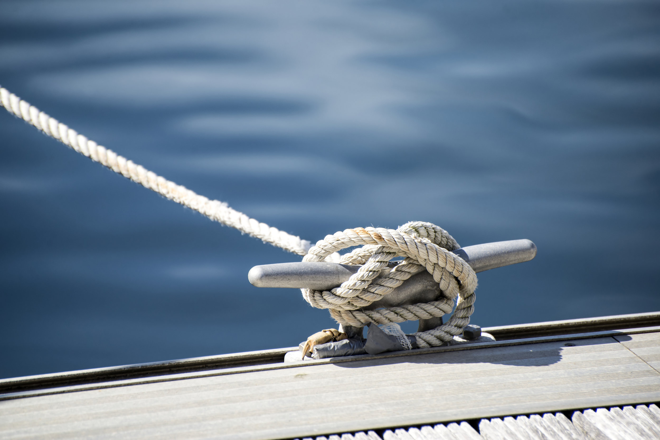 A boat cleat tied with a rope