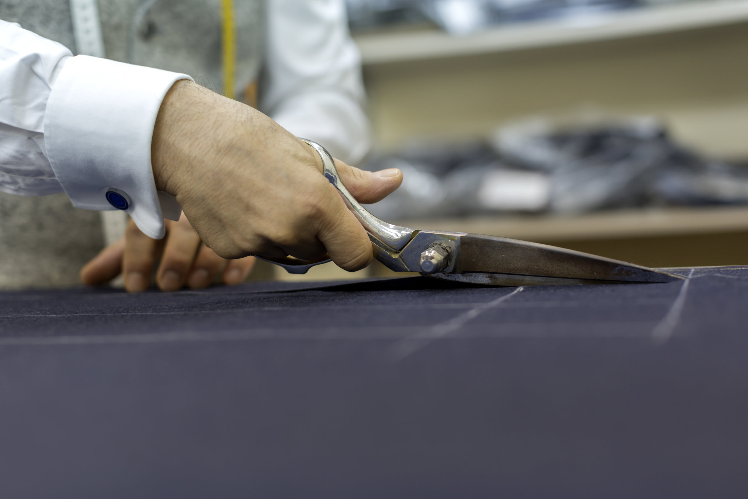 Hand cutting fabric with scissors