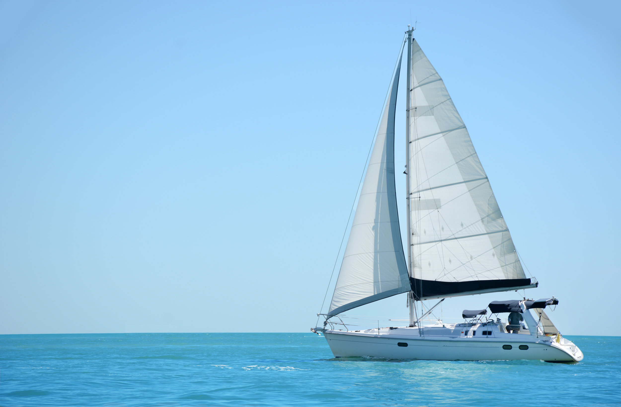 A sailboat sailing in the ocean