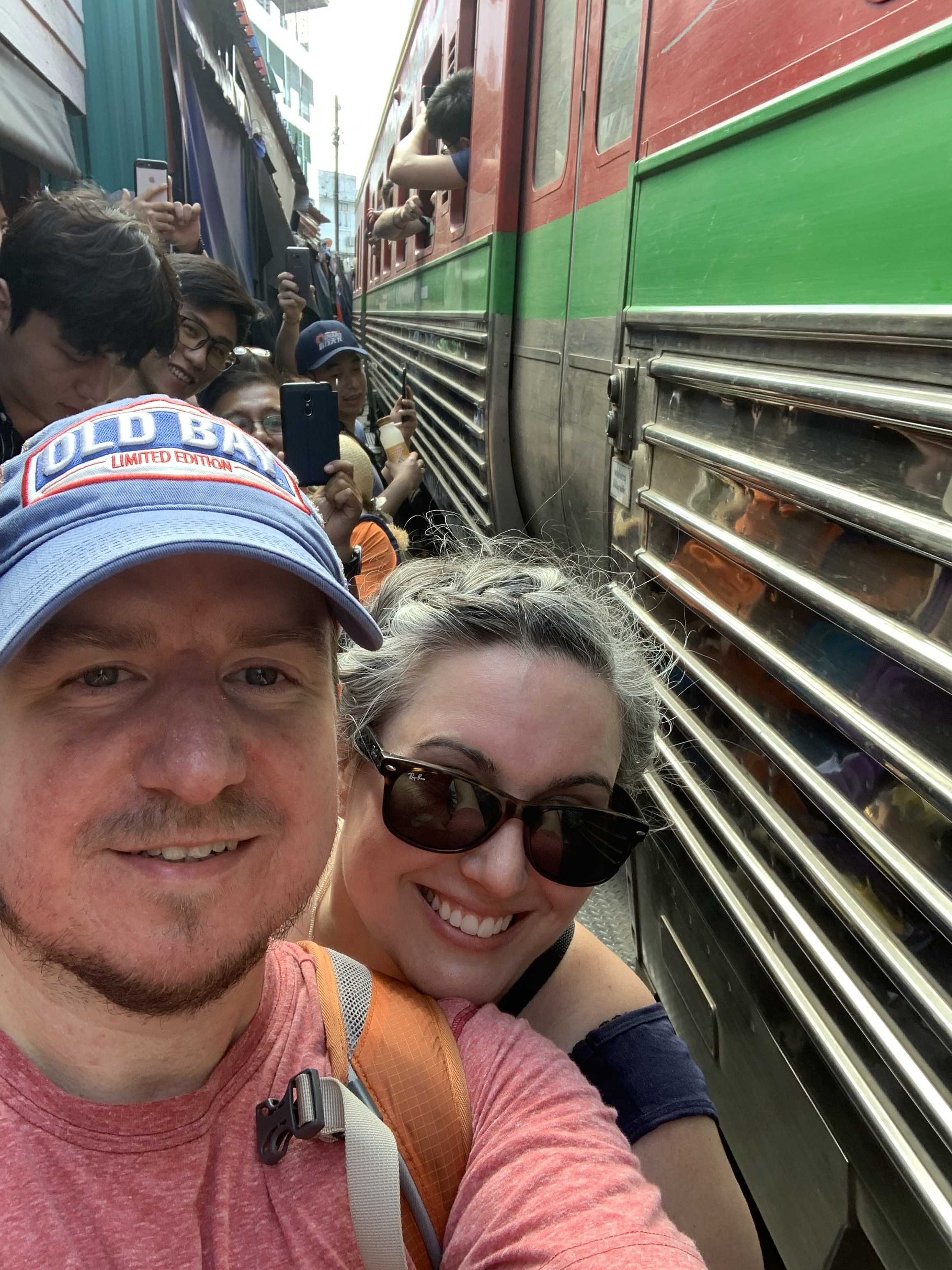 Matt and his wife, Meg, at the Maeklong Railway Market.