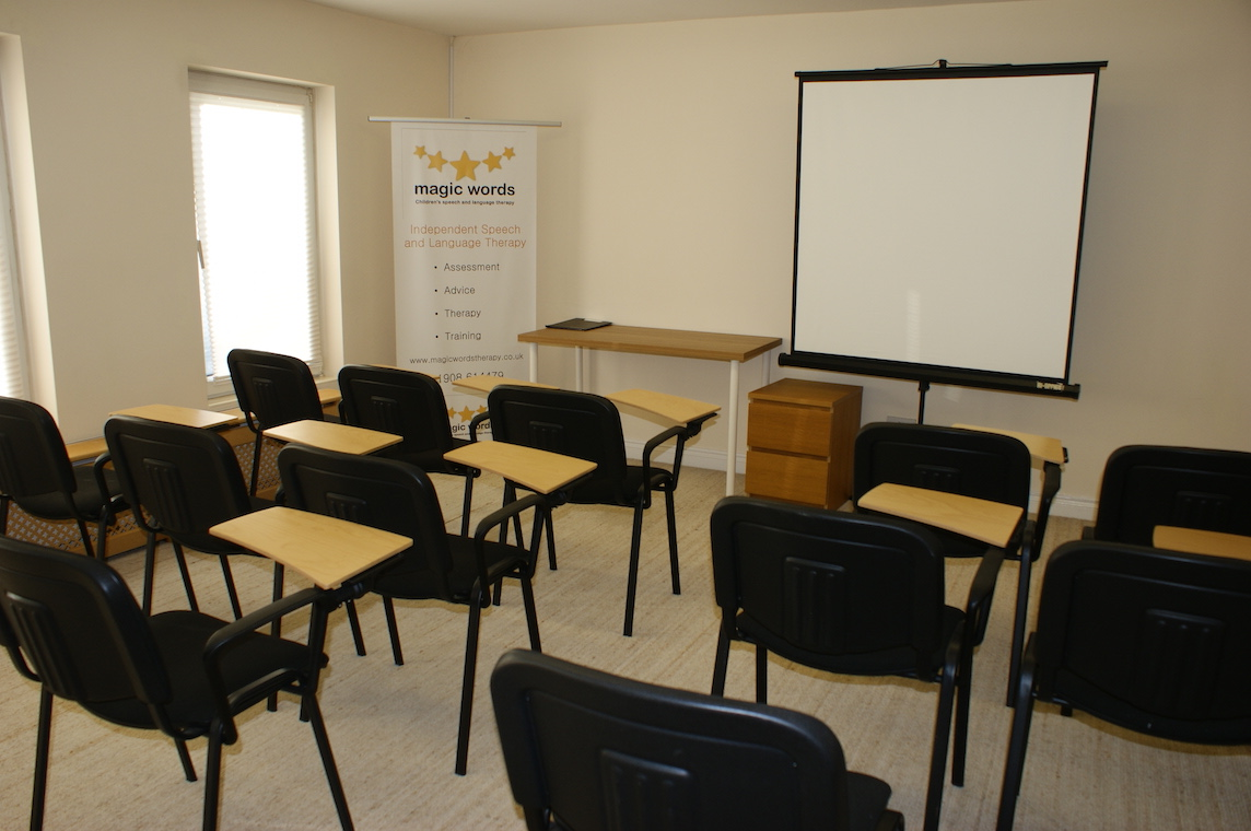 Magic Words Therapy - Training Room Newport Pagnell - Room With Chairs and Desks Facing a Whiteboard.JPG