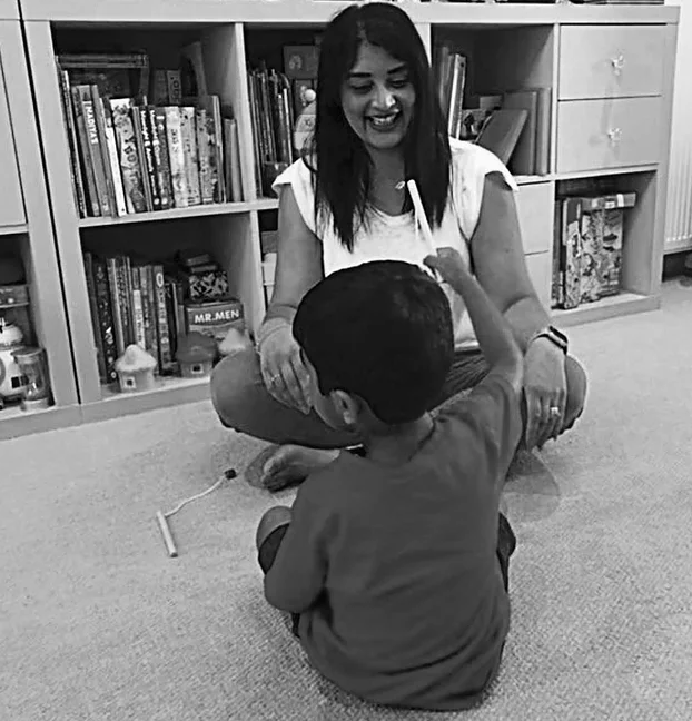 Magic Words Therapy - black and white photo of a mother and son playing.png