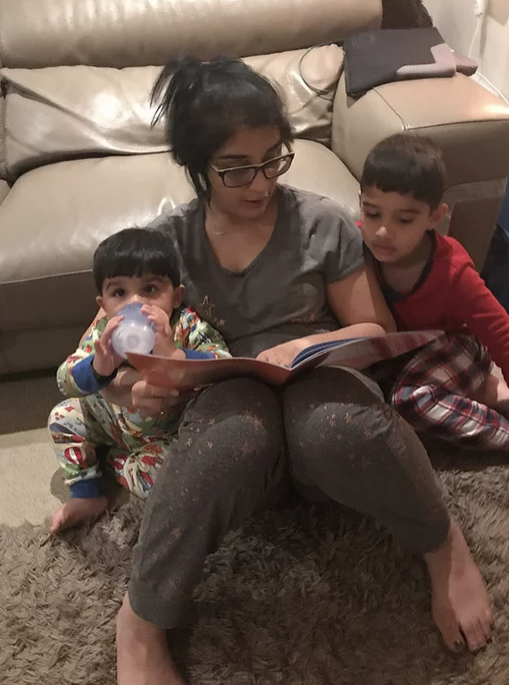 Magic Words Therapy - a mother and children reading a book