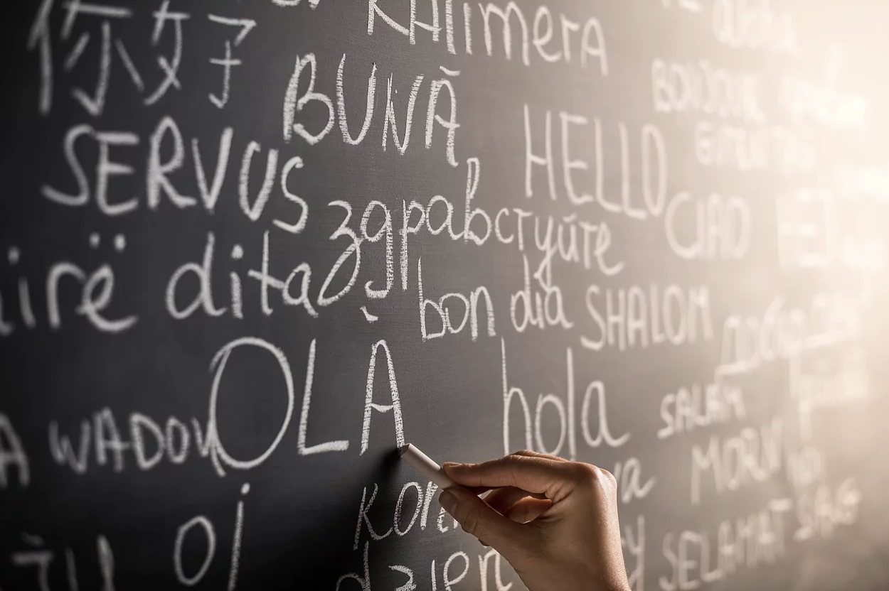 Magic Words Therapy - a hand writing on a blackboard with chalk.png