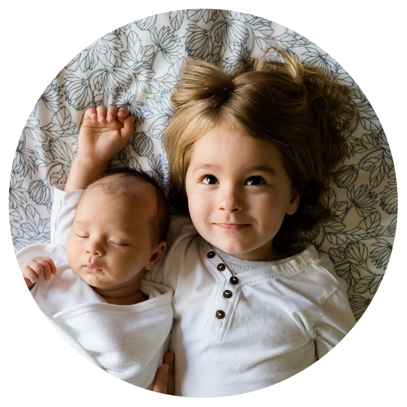 Magic Words Therapy - Children Icon - Young Siblings Lying on a Bed.png