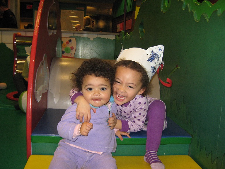 Toddlers smile at camera on the stairs of Toddler Park (Photo by Olivia Birdsall).jpg