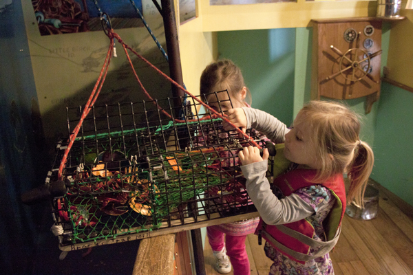 Children play with lobster trap in Lobster Boat (Photo by Olivia Birdsall).jpg