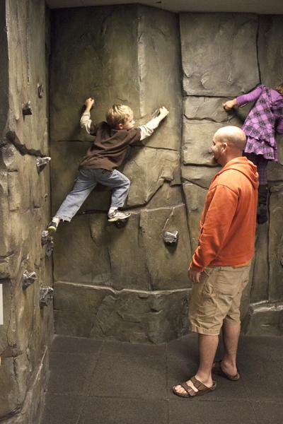 Child climbs rock climbing wall (Photo by Olivia Birdsall) (2).jpg