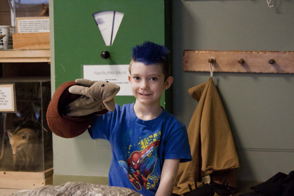 Child plays with puppetry in Ranger Station.jpg