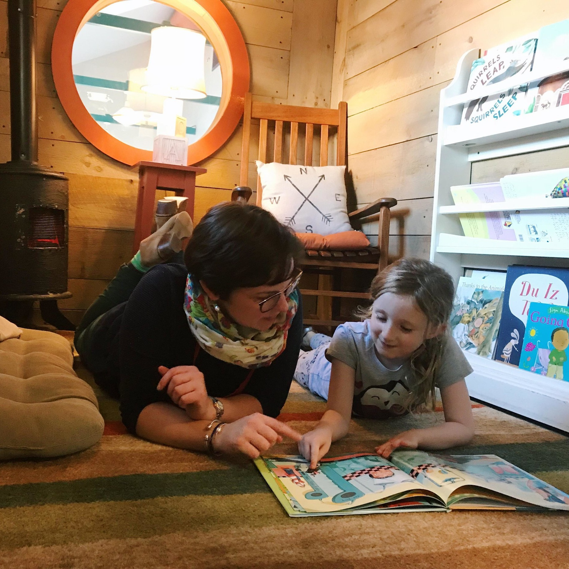 Raising Readers Book Nook - Families can explore and read together in this cozy, quiet space tucked away on the Explore Floor.