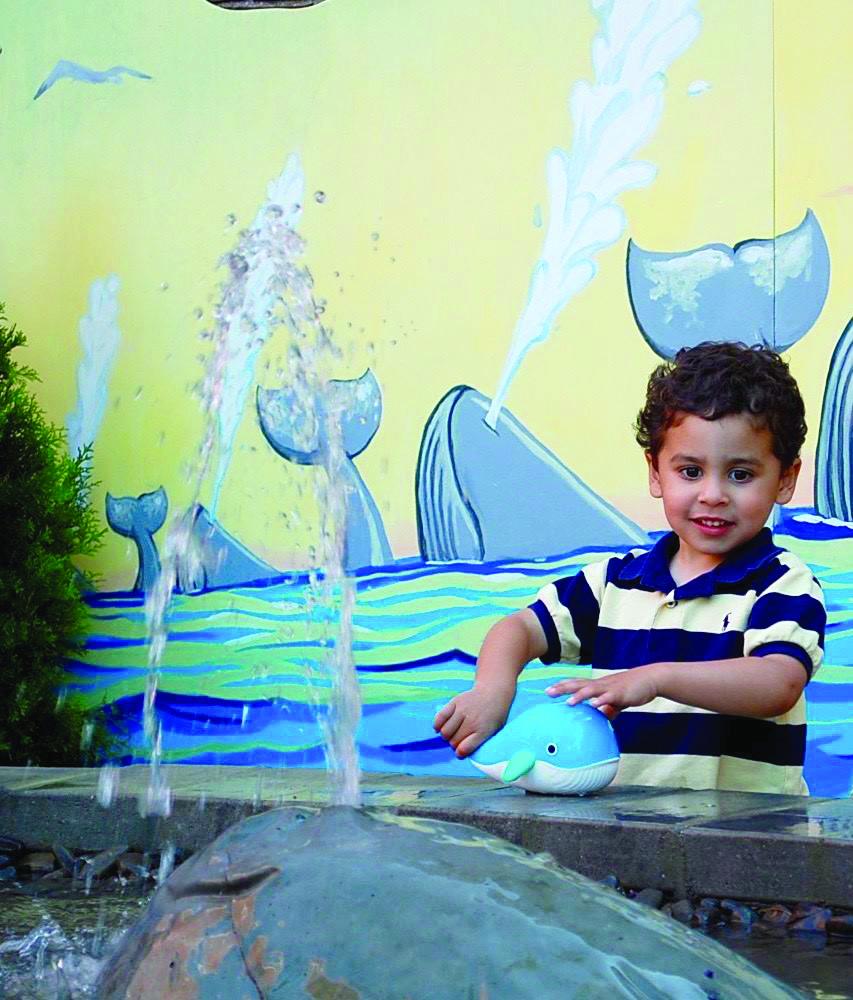 Little boy plays in the water fountain (Photo by Rachel Ross).jpg