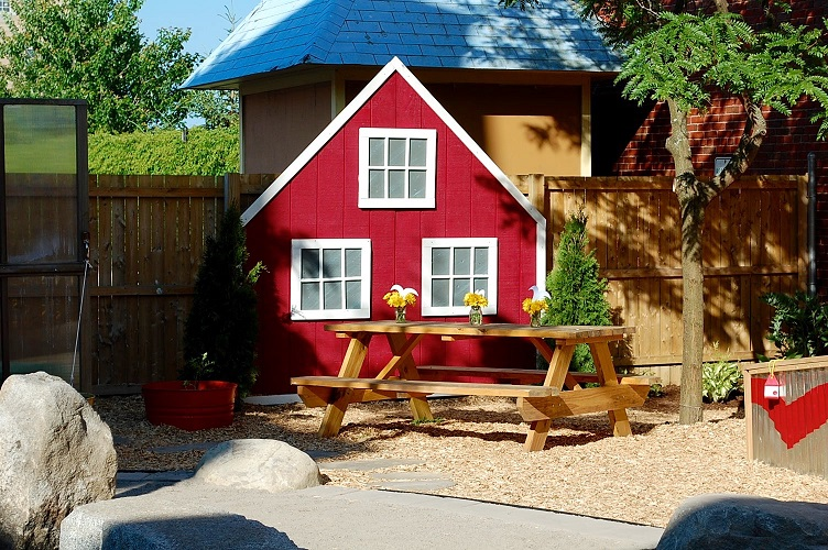 Red house and picnic table (Photo by Rachel Ross).jpg