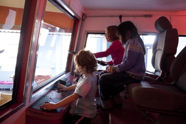 Kids play drive the Fire Truck (Photo by Olivia Birdsall).jpg