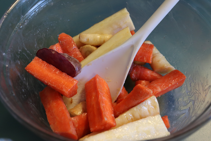 Raw root vegetables tossed in maple syrup, butter, and sea salt.