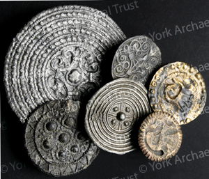 Disc brooches